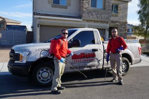 Two-exterminators-from-Dr-Death-Pest-Control-standing-near-a-truck