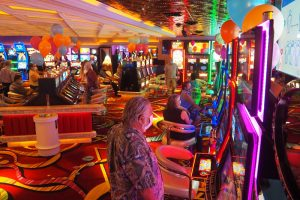 People playing on slot machines at Rainbow Club Casino
