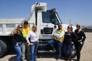The C and S Company team next to their truck
